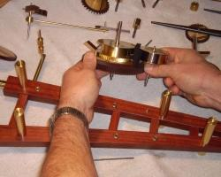 25. remove great wheel and spring storage drum